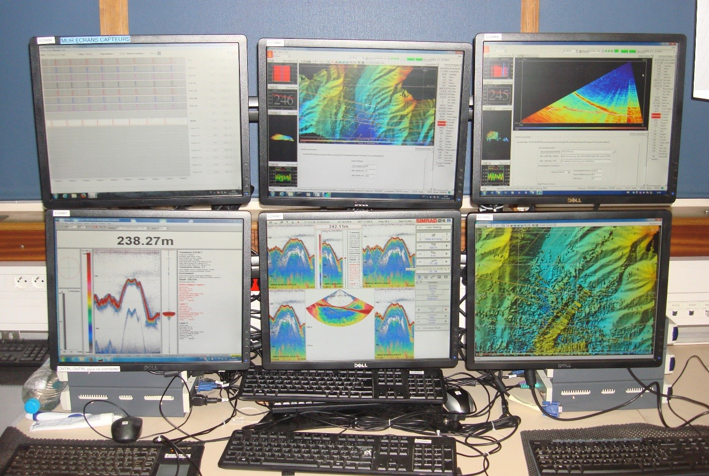 A wall of screens for the acquisition of bathymetric and water column data using the multibeam systems ME70 and EM2040 during the Fluid3D campaign aboard the R/V L'Europe